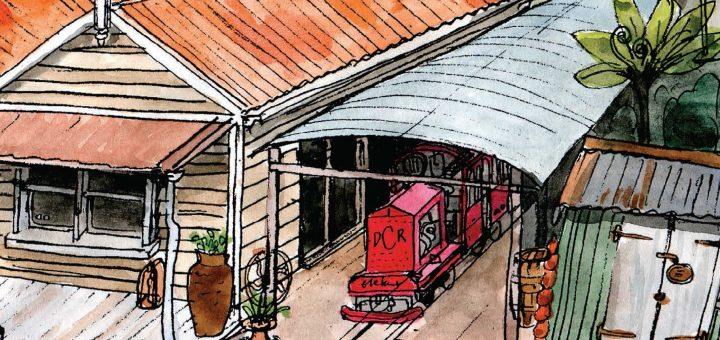 "train engine ""Elephant"" under curved corrugated roof"